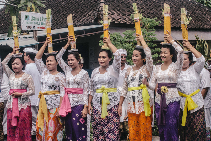 Holy water on their heads, Bali